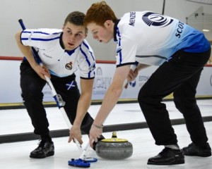 Angus Dowell and Duncan Menzies sweeping it onto the spot