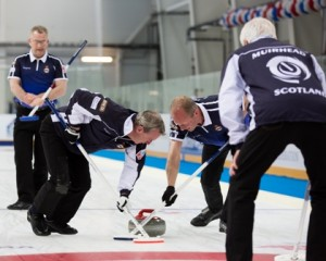 the men's team in action